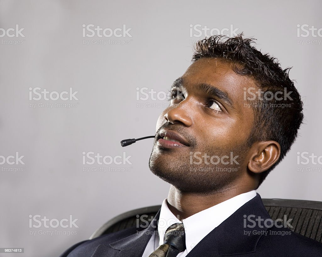 attractive young businessman looks to future royalty-free stock photo