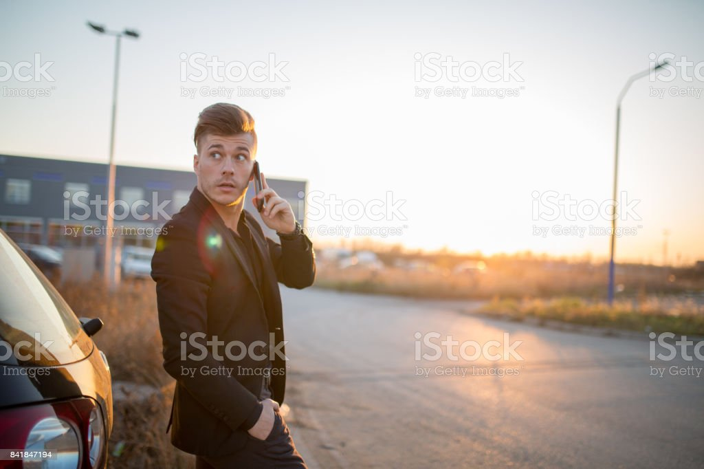 Attractive young businessman talking on the phone stock photo