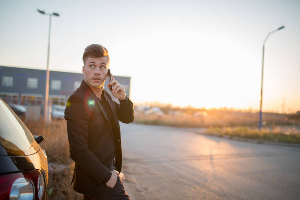 Attractive young businessman talking on the phone Attractive young businessman talking on the phone alongside stock pictures, royalty-free photos & images