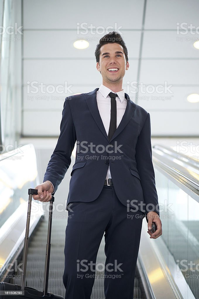 Attractive young businessman traveling with bag royalty-free stock photo