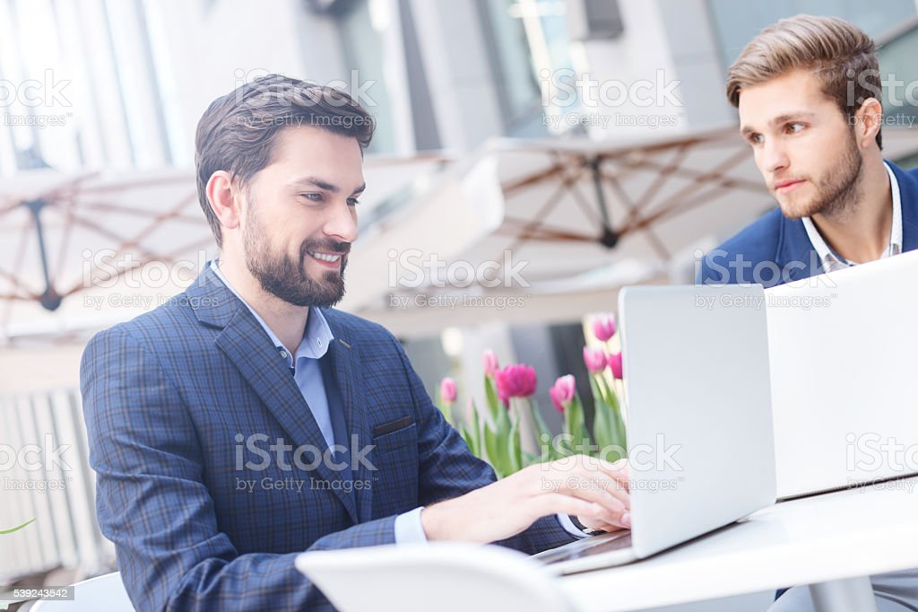Attractive young businessmen have an appointment in restaurant royalty-free stock photo
