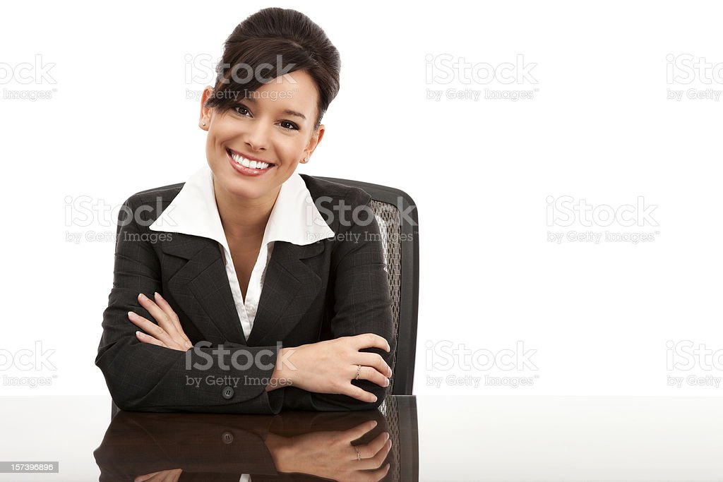 Attractive Young Businesswoman at Desk royalty-free stock photo