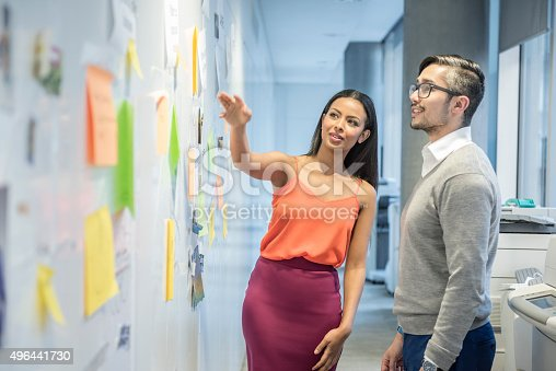istock Attractive young businesswoman discussing with male colleague 496441730