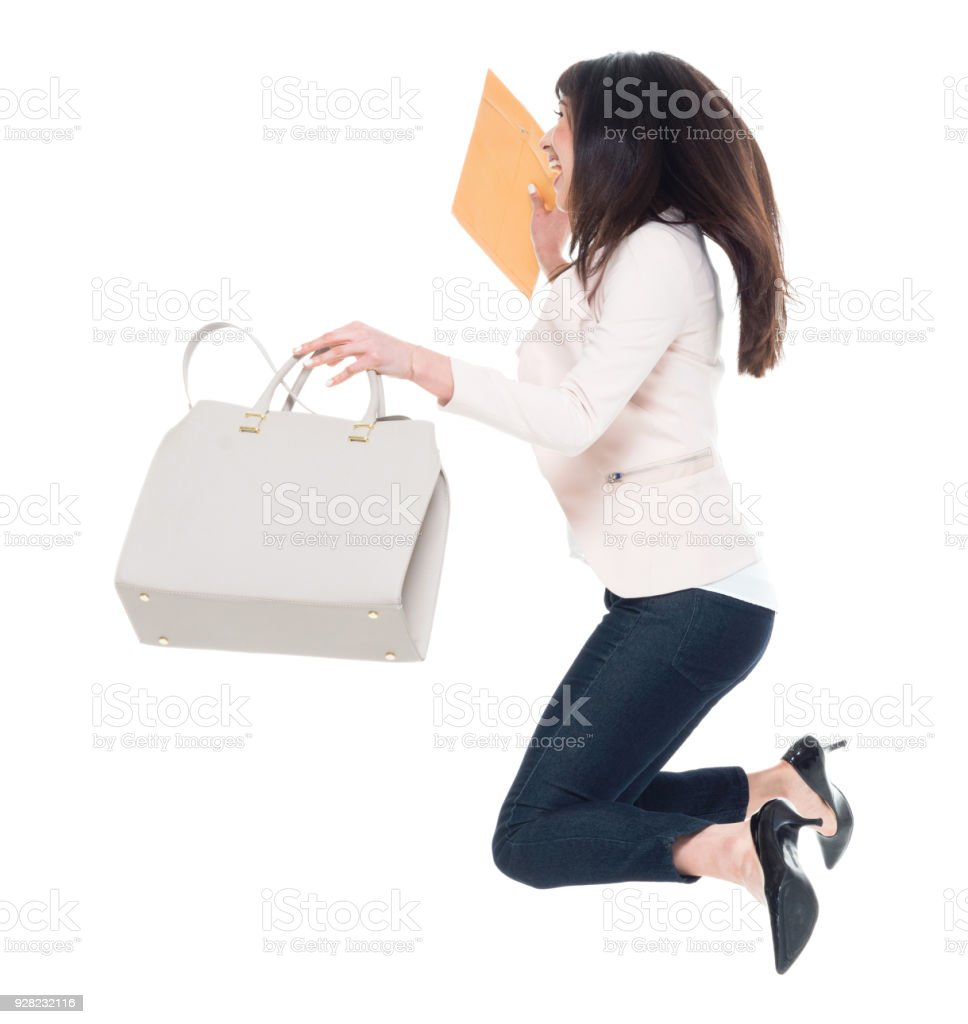 Attractive young businesswoman jumping and having fun stock photo