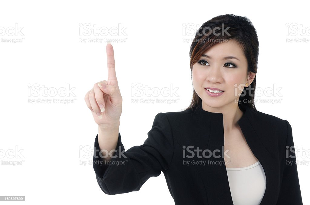 Attractive young businesswoman pressing a button royalty-free stock photo