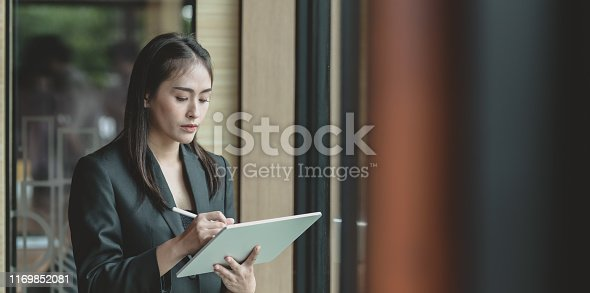 1068752548istockphoto Attractive young businesswoman reviewing the previous project 1169852081