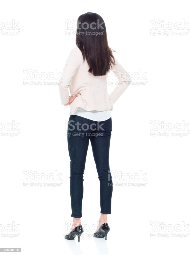 Attractive young businesswoman with hands on hips stock photo