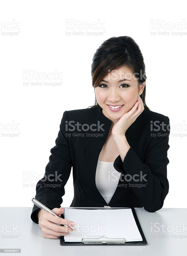 Attractive young businesswoman writing document royalty-free stock photo