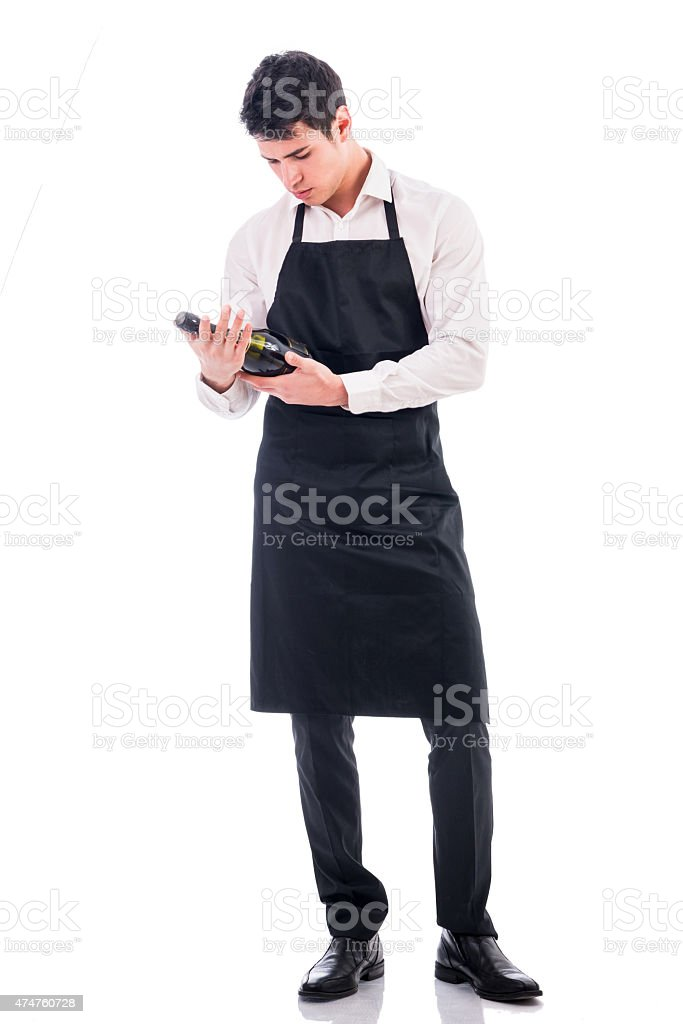 Attractive young chef holding green champagne bottle stock photo
