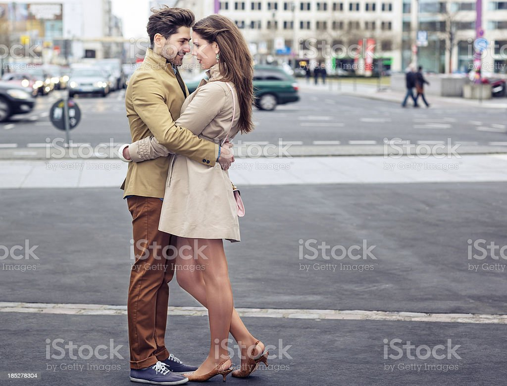 Attractive Young Couple Embracing on Potsdamer Platz royalty-free stock photo