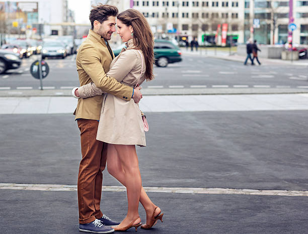 Attractive Young Couple Embracing on Potsdamer Platz stock photo
