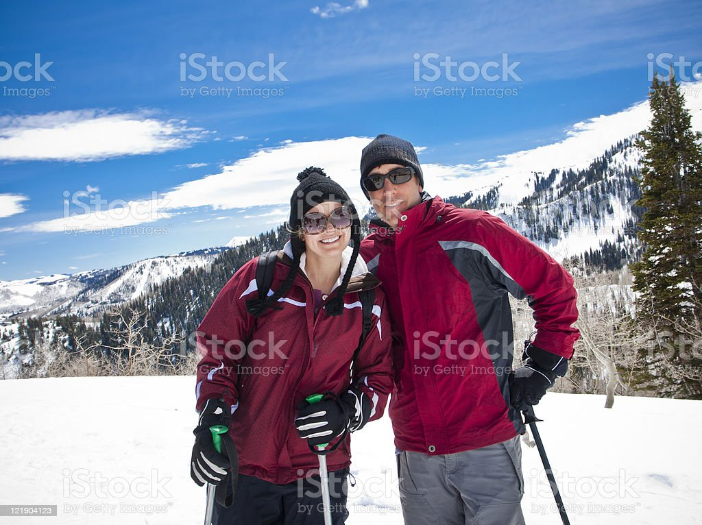 Attractive Young Couple on a Ski Vacation royalty-free stock photo