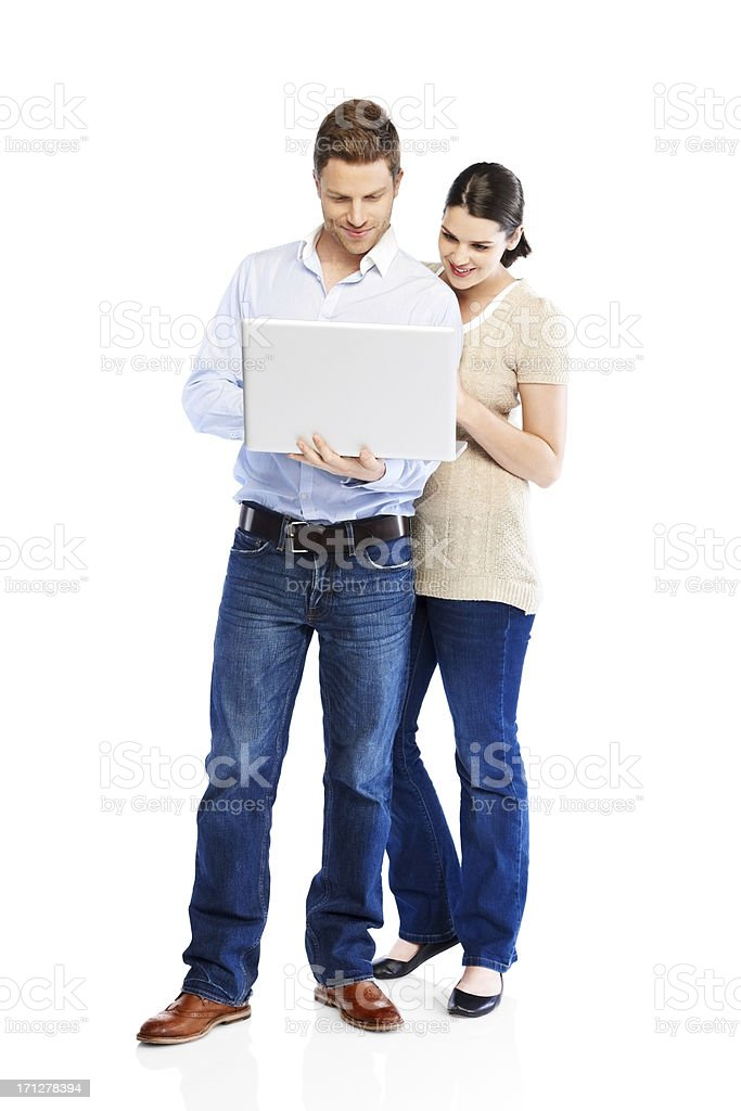 Attractive young couple using laptop on white royalty-free stock photo