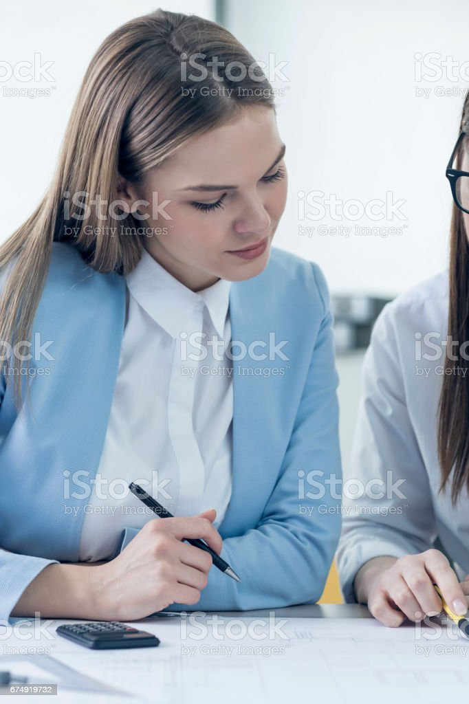 Attractive young designer sitting in her office royalty-free stock photo