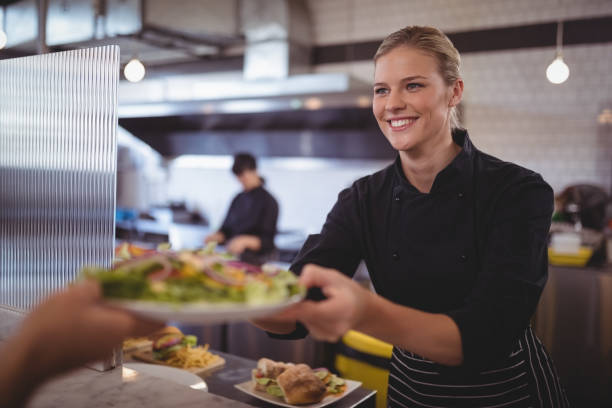Attractive young female chef giving fresh greek salad to waiter picture id844731372?b=1&k=6&m=844731372&s=612x612&w=0&h=vu8i8fv6gu trtac91uxppcc51bz1oymie5k8d ydwk=