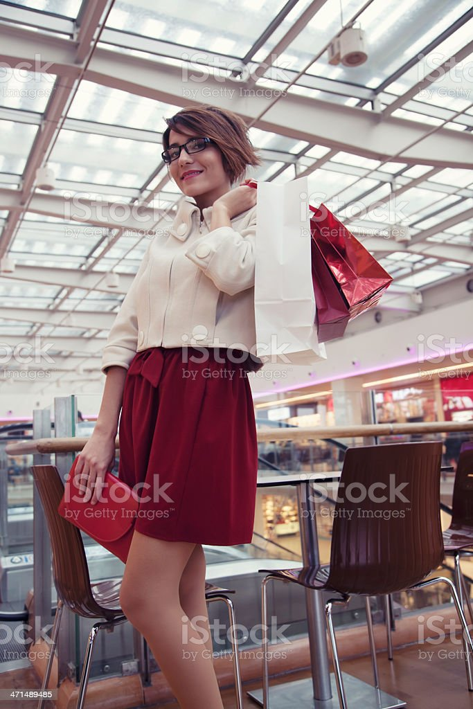 Attractive young female holding shopping bags royalty-free stock photo
