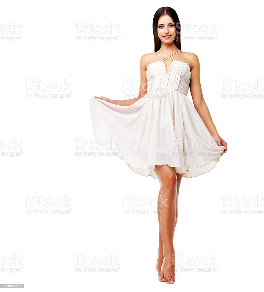 Attractive young female in white dress stock photo