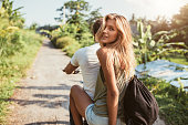 istock Attractive young female on bike with her boyfriend 588591246
