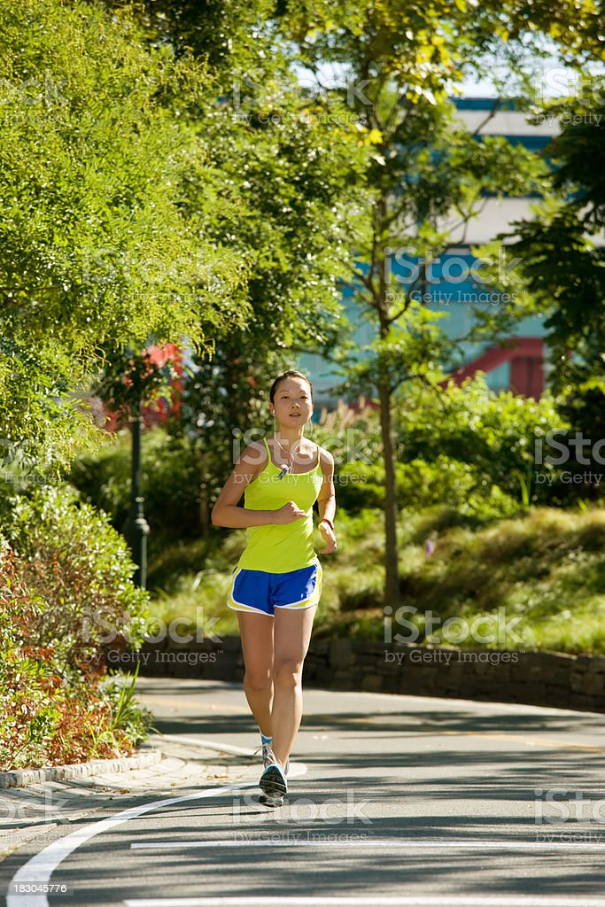 attractive young Female runner jogging in park royalty-free stock photo