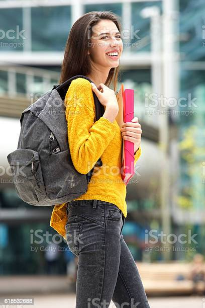 Attractive young female student walking to class with book bag picture id618532688?b=1&k=6&m=618532688&s=612x612&h=8vqred9ophqfk4jdgn7i2ooai8mrpy2e2s15ao2oqwa=