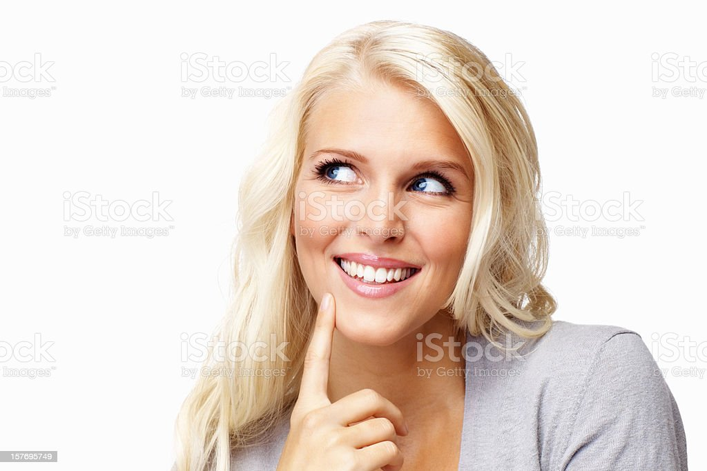 Attractive, young female with finger on chin looking at copyspace royalty-free stock photo