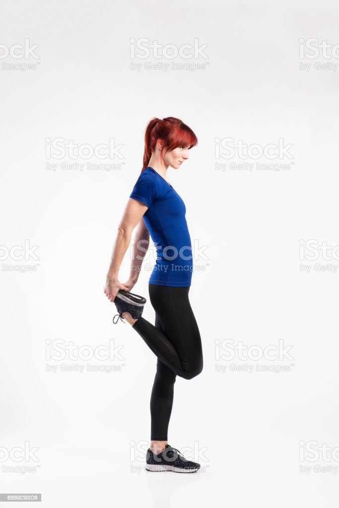 Attractive young fitness woman in blue t-shirt. Studio shot. stock photo