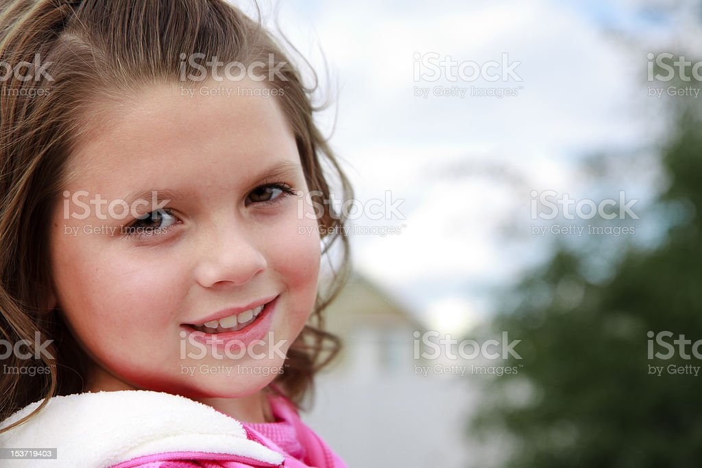 Attractive young girl enjoying outdoor royalty-free stock photo