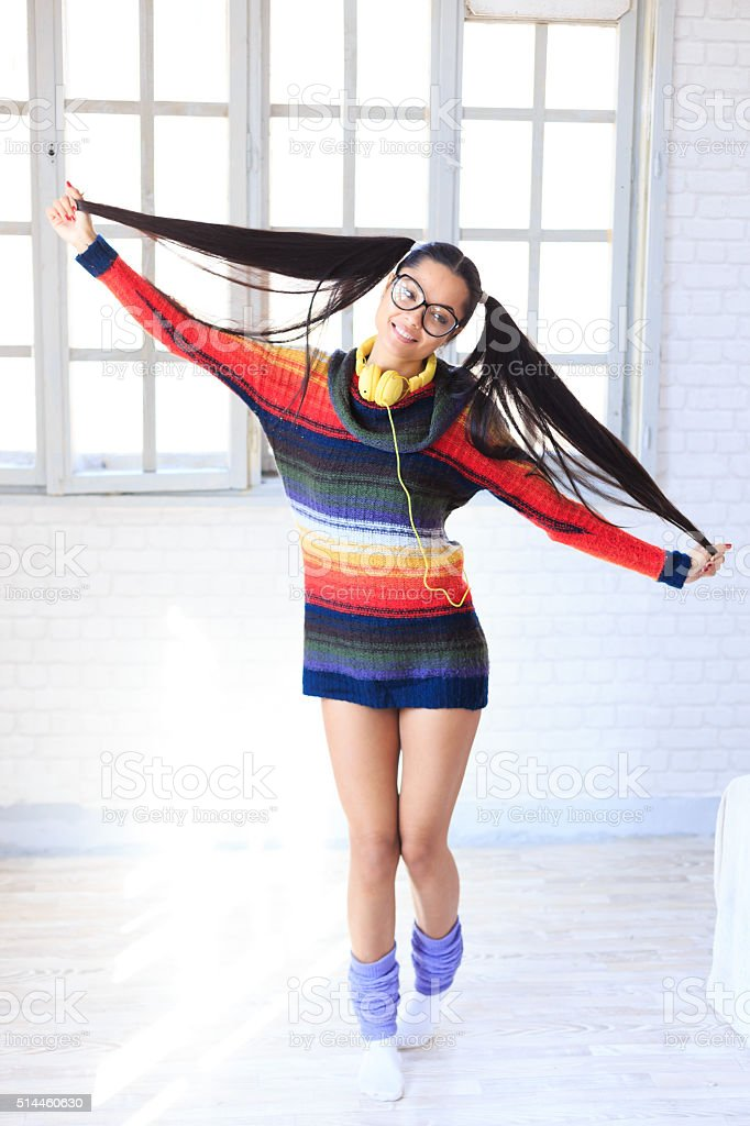 Attractive young girl jumping stock photo