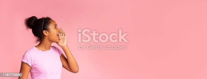 Attractive teenage girl shouting at copy space, making announcement, sharing news on pink studio background. Website banner, panorama