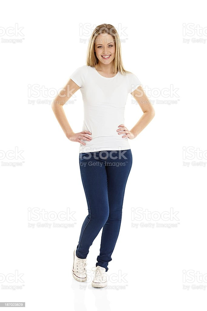Attractive young girl standing with her hands on hips royalty-free stock photo