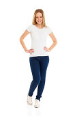 istock Attractive young girl standing with her hands on hips 187023829