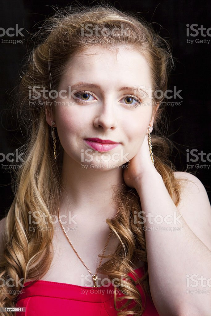 Attractive young girl wearing red on black royalty-free stock photo