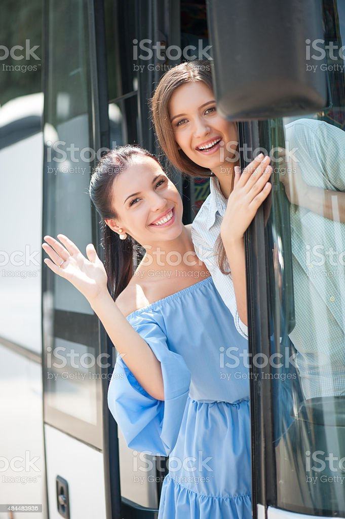 Attractive young girls are going on a journey stock photo