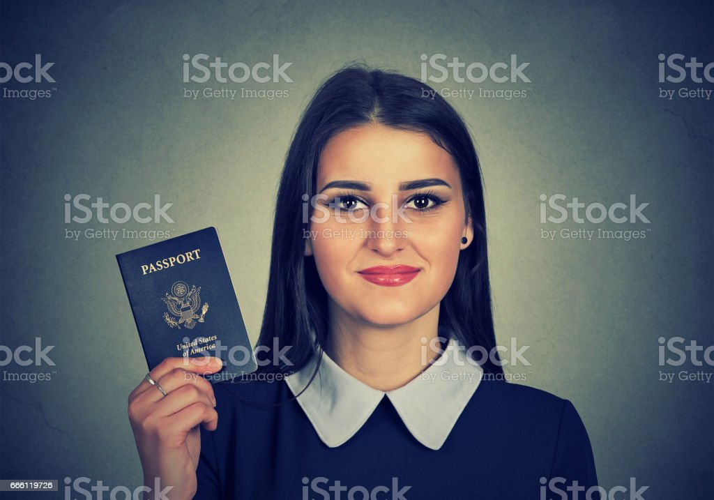 attractive young happy woman with USA passport stock photo
