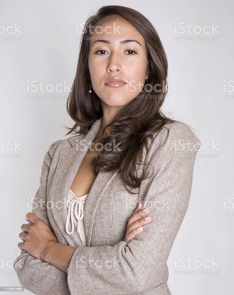 Attractive young Hispanic business woman poses confidently royalty-free stock photo