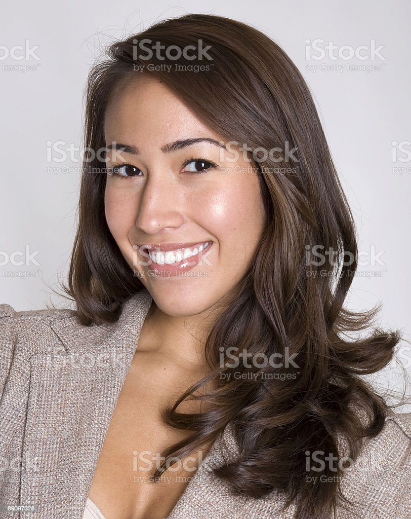 Attractive young Hispanic businesswoman poses confidently royalty-free stock photo