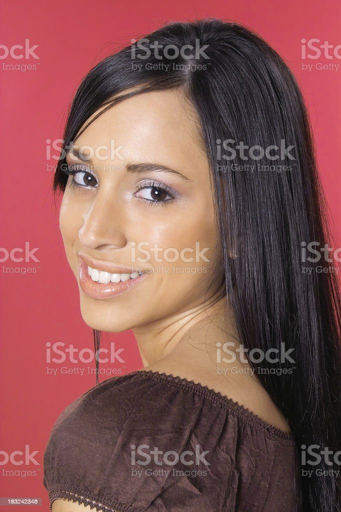 Attractive Young Hispanic Woman on Red royalty-free stock photo