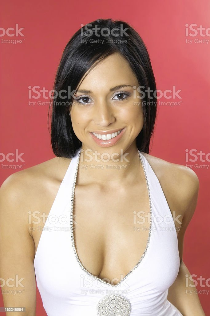 Attractive Young Hispanic Woman on Red stock photo