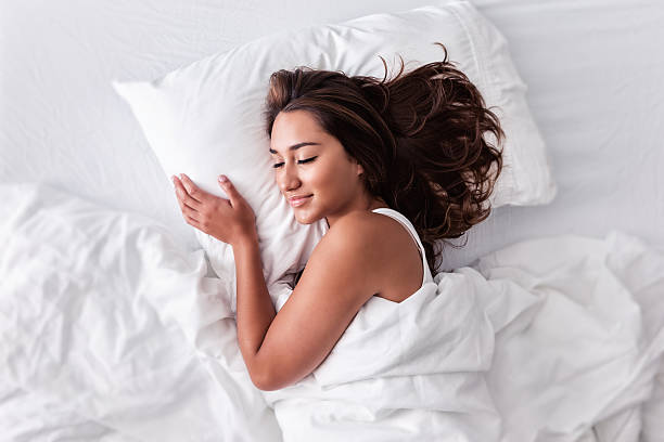 Attractive Young Hispanic Woman Sleeping Blissfully stock photo