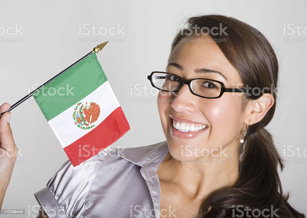Attractive young Hispanic women waves Mexican flag royalty-free stock photo
