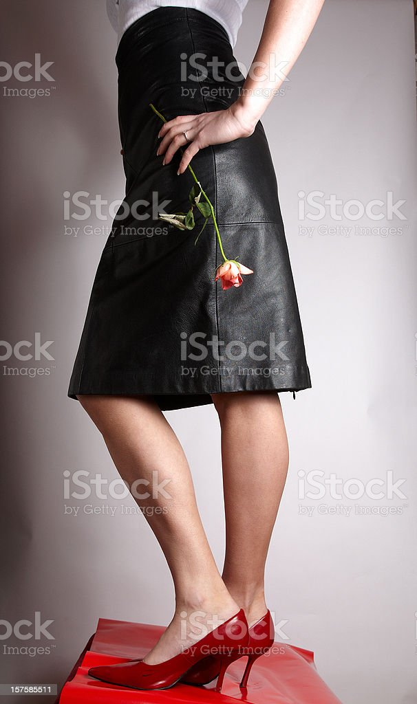Attractive young lady black leather skirt stock photo