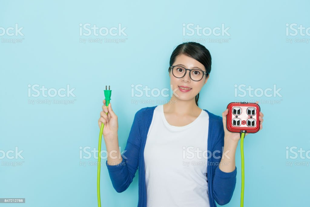 attractive young lady showing plug with socket stock photo