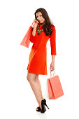 istock Attractive young lady with shopping bags 453920615