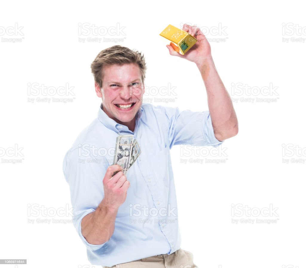 Attractive young male holding gold bars stock photo
