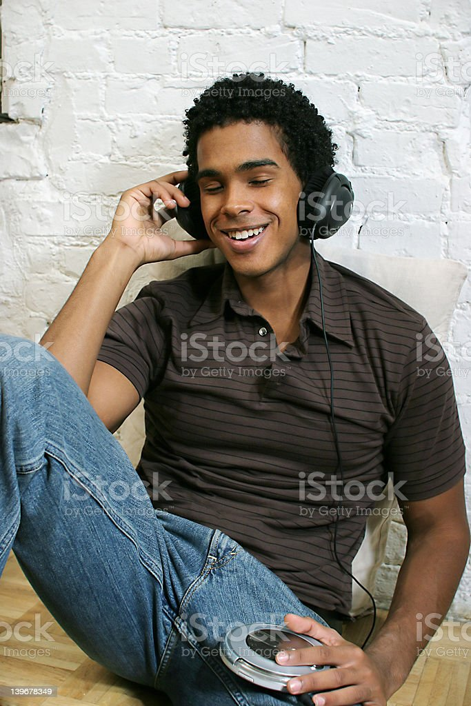 Attractive Young Male listening to music stock photo