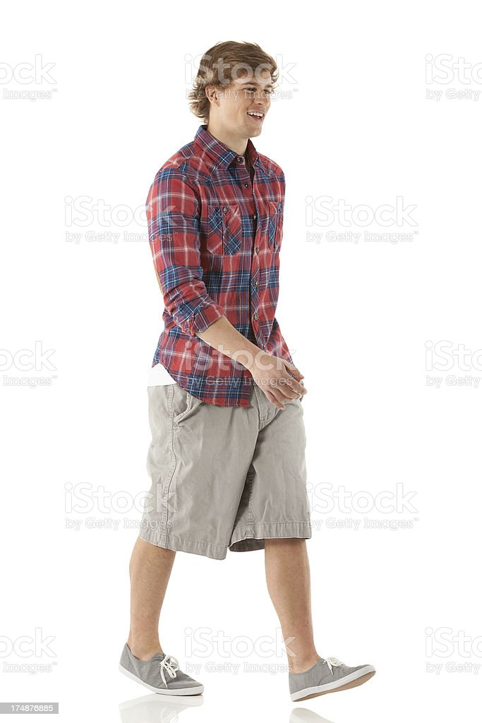 Attractive young male walking stock photo