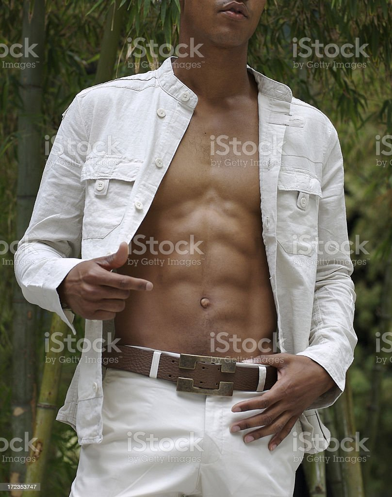 Attractive Young Man Baring His Chest Bamboo Background royalty-free stock photo