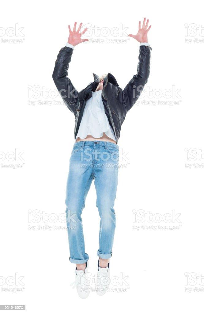 Attractive young man doing backflips stock photo