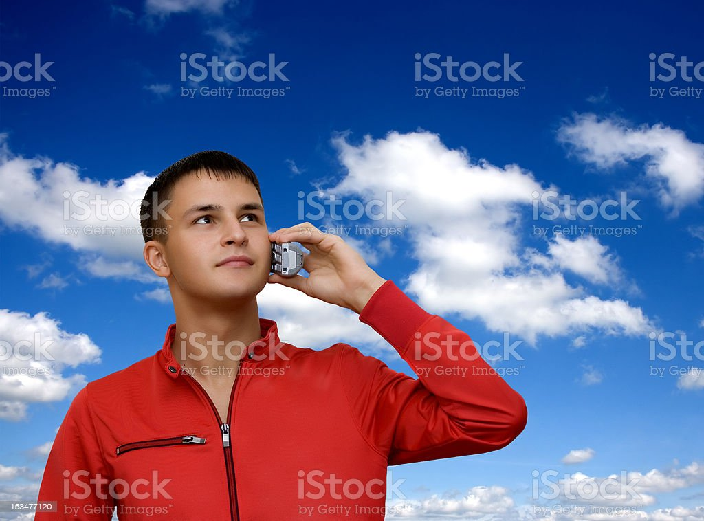 Attractive young man holding out cellphone. royalty-free stock photo