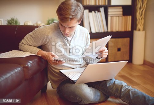 attractive young man in home interior